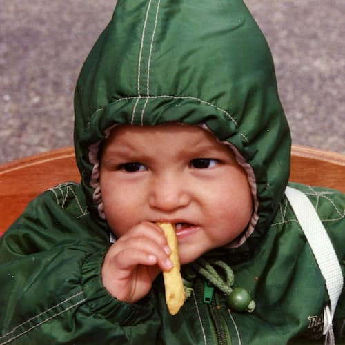 Photo of Andrea as a baby eating
