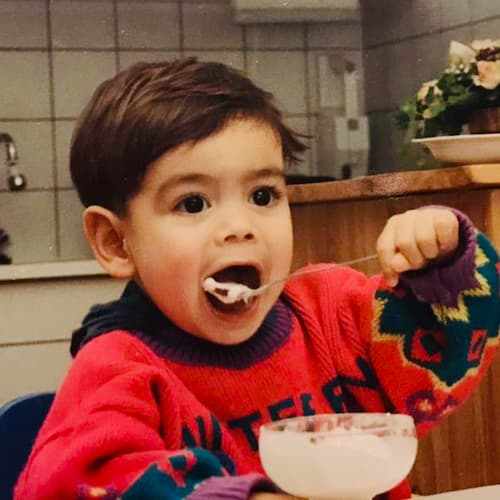 Photo of Robin as a baby eating
