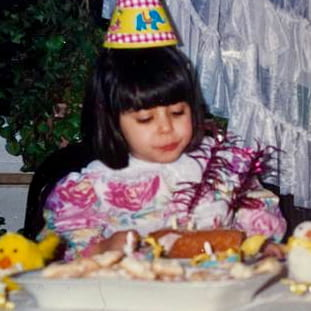 Photo of Sadia as a baby eating