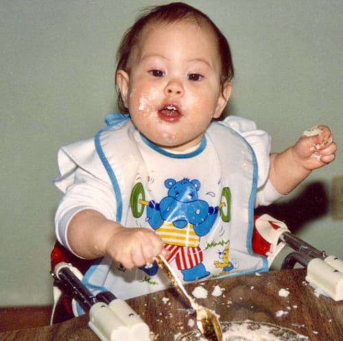 Photo of Suzy as a baby eating