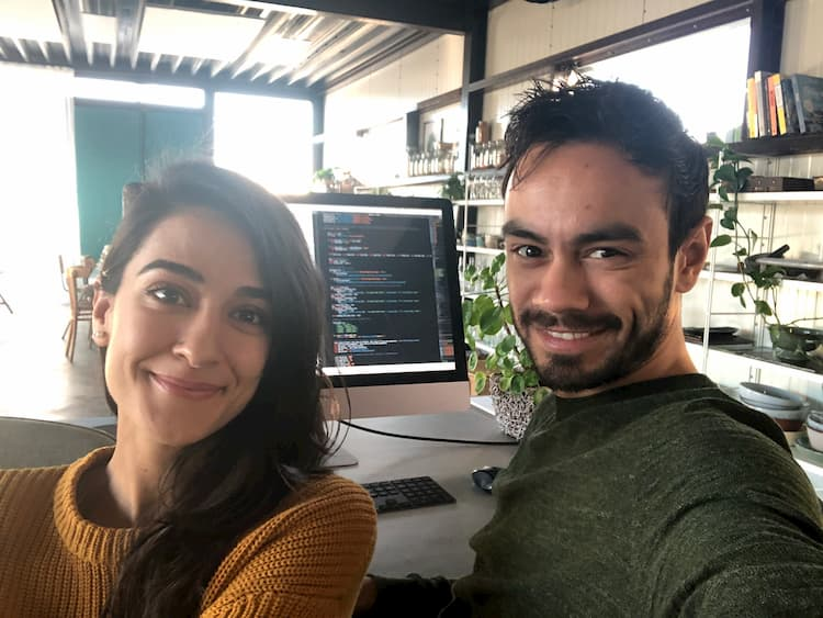 Photo of Sadia and Robin working together on the website.